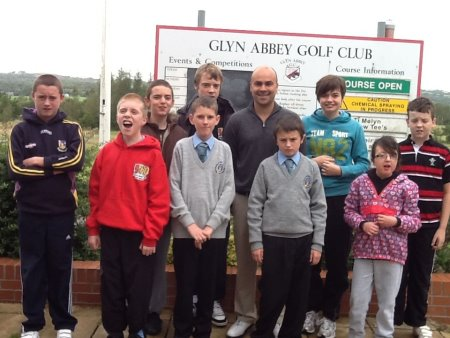 Glyn Abbey golf professional Mike Davies with pupils from Maes-Yr-Yrfa School
