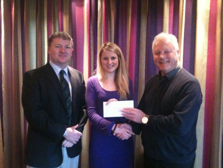 Jeannie Pitt, the local Cancer Research UK area organiser, receives her cheque from Bob Cooper