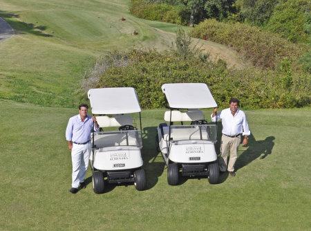 General manager Lucas de la Puente with Pedro Moran of Green Mowers and the E-Z-GO TXT buggies at Almenara Golf Club