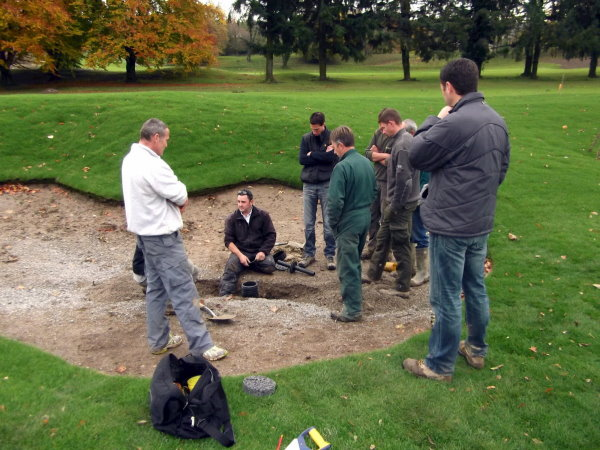 Jeremy Parkman of MJ Abbott Ltd provides training in Bunker Plug installation to course construction and greens' staff at the Evian Masters Golf Club, France, which has been remodelled and upgraded over the past 18 months