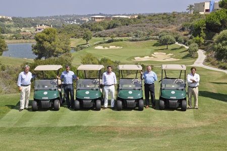 The E-Z-GO RXV golf cars at La Reserve with General manager Lucas de la Puente (centre) and representatives from Green Mowers and E-Z-GO