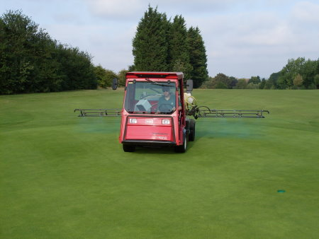 Lee Sayers Course Manager of Mid Kent Golf Club spraying Tricure on the 15th green