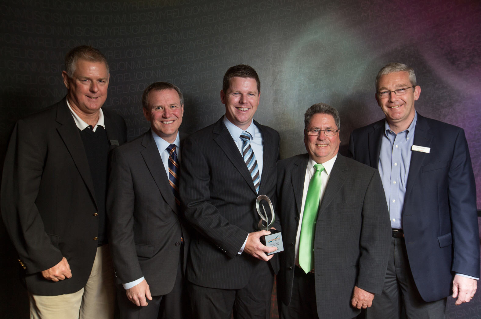 Power Turf New Zealand Ltd  are presented with the Service Dealer of the Year award