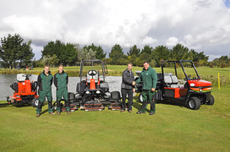 Dave Bush of Ernest Doe & Sons hands over the new equipment to Rustington's course manager Grant Burger (far right)