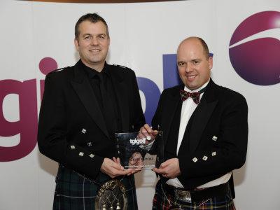 Michael Brooks (left), PGA Professional at Malton & Norton Golf Club receives his TGI Golf Partnership Partner of the Year award from group Chairman Gordon Stewart.
