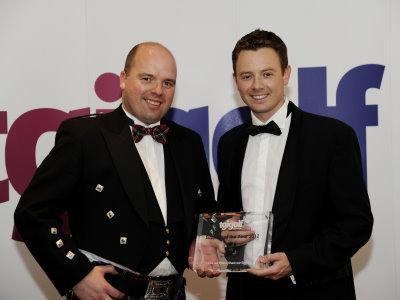 FootJoy EMEA Sales & Marketing Director Richard Fryer (right) collects the Supplier of the Year Award from TGI Golf Chairman Gordon Stewart.