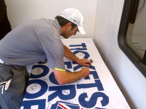 Flag being signed by Franceso Molinari, one of many European Tour players who signed the flag during the 2012 Johnnie Walker Championship