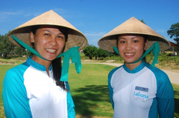 Two of Laguna Lang Co's new caddies, Thao Nguyen and Quyen Dang