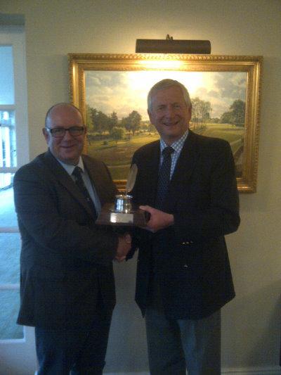 Mike Harris of the AGW (left) congratulates Golf Foundation Chairman Charles Harrison