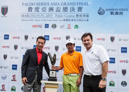 Luo Xue-Wen of China receives the Faldo Series Asia trophy from Sir Nick Faldo and Tenniel Chu, Vice Chairman of Mission Hills Group at Mission Hills Golf Club in Shenzhen, China.