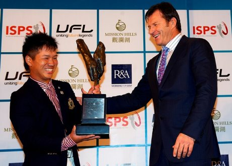 Masamichi Ito of Japan receives the 2012 Faldo Series Asia trophy from Sir Nick Faldo at Mission Hills Golf Club in China