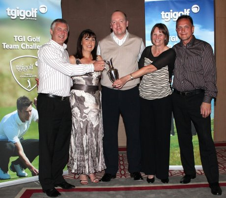 Chris Gray (left) and his team - Carol Gray, Andy Woodhead and Maxine Woodhead - are presented with their trophy by Giles Birkhead, TMaG Regional Sales Manager (centre)