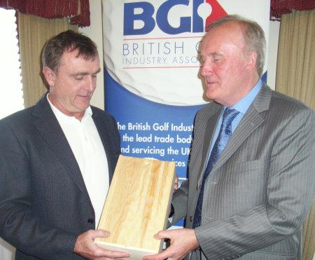 BGIA Chairman Nigel Freemantle (left) hands over a token of thanks to former Chairman Doug Poole.