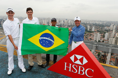 Gary Player with three young Brazilian golfers on the helipad on the roof of CentenarioPlaza, one of the tallest buildings in Sao Paulo (L-R: Daniel Stapff, Rafael Becker, and Cristian Barcelos)