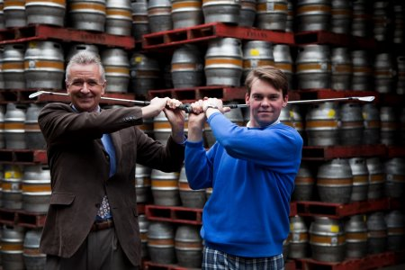 Paul Clouting, general manager Thorpeness Hotel and Golf Club, swings right handed and Christopher Oldrey, PGA Professional at Thorpeness Hotel and Golf Club swings left handed at Adnam's Brewery to launch the Suffolk Ale and Golf Trail