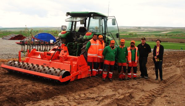 BLEC's Tom Shinkins with the Blecavator and FBK staff at their turf farm near Ankara, Turkey