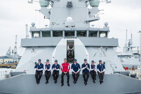 Royal Navy golf team members on board the new Type 45 class warship HMS Duncan in Portsmouth Dockyard with Commander Kevin Seymour (right centre) and Premium Golf's Alex Nicolson (left centre)
