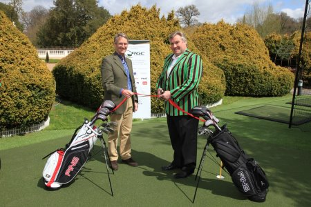 Help for Heroes founder Bryn Parry watches International Rugby star Jason Leonard cut the tape to open the new Huxley all-weather golf practice facility at the Help for Heroes Tedworth House Recovery Centre