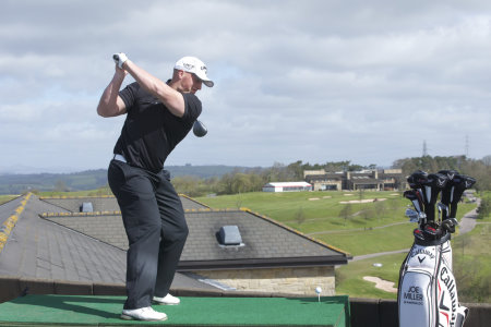 2010 World Long Driving Champion Joe Miller driving from the roof of the Celtic Manor Resort.