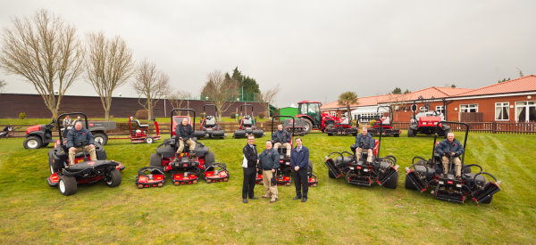 Course manager Phillip Benn, front centre, shakes hands with Lely's Larry Pearman, with Phil Beeny from John Shaw Machinery to his right. The greenkeeping team look on.