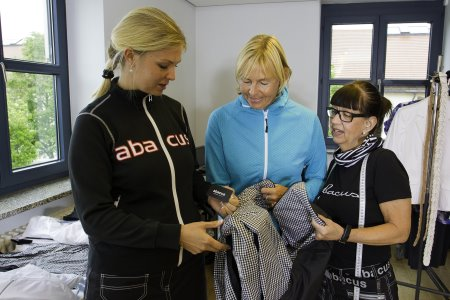 (from left) Alexandra Yllo (Abacus Sportswear Event & Partner Manager), Liselotte Neumann (European Solheim Cup Captain), Martell Nielsen (Abacus Sportswear Head Seamstress)
