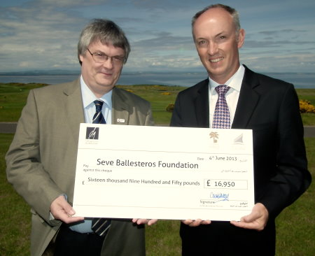 Dubai Golf's Chief Executive Officer, Christopher May, presents the cheque for £16,950, to Richard Cowie from Cancer Research UK, which works in partnership with the Seve Ballesteros Foundation. The presentation took place in St Andrews, Scotland, where Seve won The Open Championship in 1984