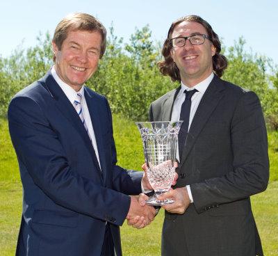 George O'Grady CBE, Chief Executive of The European Tour, receives his Lifetime Achievement Award from Andrea Sartori, Head of KPMG's Golf Advisory Practice