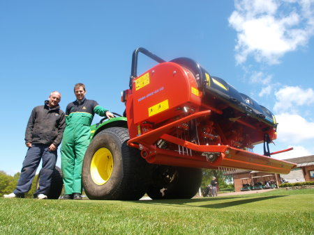 Head greenkeeper at Kedleston Park Golf Club, David Leatherland, ( left) with Henton & Chattell's James Robson with the newly acquired Wiedenmann Terra Spike GXi8 HD