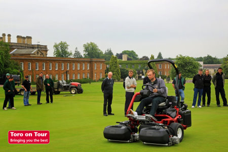 Visitors at a Toro on Tour 2013 event at Heythrop Park look on as a Toro TriFlex Hybrid 3420 is put through its paces.