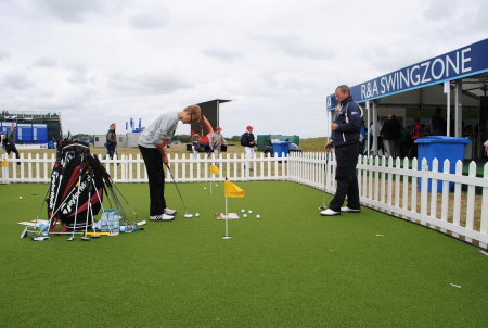 Fans receive expert tuition on the Huxley Golf putting green at last year's Open Championship