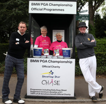 Actor Philip Glenister and Radio 2 DJ Chris Evans help with programme sales at the BMW PGA Championship