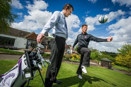 Addington Court GC General Manager Clive Hartley(l) watches 25-year old Chris McClatchie, Academy Professional at the golf club, hone his ball skills before this weekend's Footgolf event.