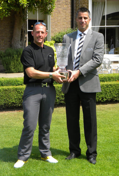 Craig Thomas (left) collecting his award from PGA in England (Midlands) secretary James Brown