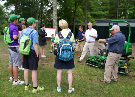 Ren Wilkes, regional sales manager for John Deere Golf, shows students the benefits of John Deere's E-Cut hybrid technology