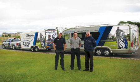 John Letters Tour trucks and John Andrew (left).