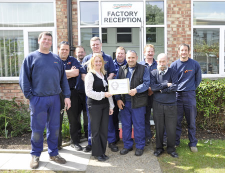 Gemma Cosby with Ransomes Jacobsen's health and safety committee and the company's gold award certificate