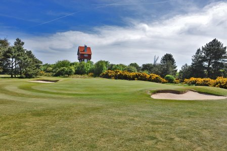 Britain's greenest golf course – The 18th hole at Thorpeness overlooked by the House in the Clouds