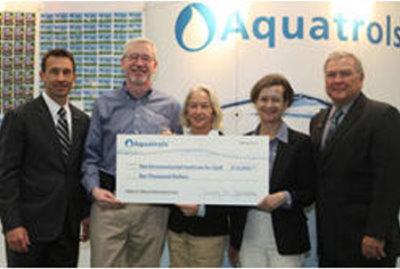 (from left) Rhett Evans, GCSAA CEO; Andy Moore, Aquatrols director of sales; Demie Moore, Aquatrols corporate relations; Tracy Jarman, president/CEO of Aquatrols; and Sandy Queen, CGCS, GCSAA immediate past president