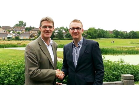 Mike Round, Chief Executive of the Golf Foundation (left), shaking hands on the partnership with Richard Barker, General Manager of Teeofftimes.co.uk, at Collingtree Park Golf Club