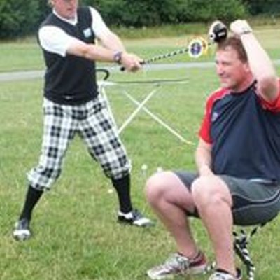 Matt Pinsent on his knees with a golf ball on his head!