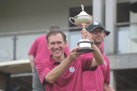 TGI Golf Captain Peter Hanna holds the Ashworth Cup aloft