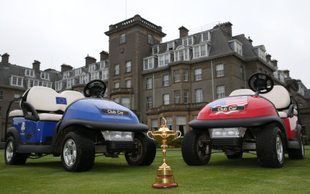 Ryder Cup trophy and two Club Cars outside Gleneagles