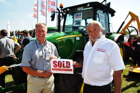 Speedcut Contractors md Dick Franklin (right) with Peter Helps of Farol Ltd and the new John Deere 5100M purchased on the Farol stand at SALTEX 2013