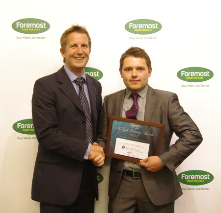 Motocaddy Marketing Manager Oliver Churcher (right) receives the 'Most Innovative Product' award from Foremost Director Andy Martin
