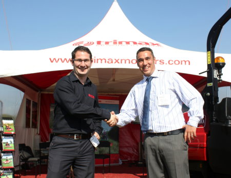 Michael Sievwright of Trimax (left) shakes hands on the new dealership arrangement with Lister Wilder's Phil Hughes at the IOG SALTEX show in September