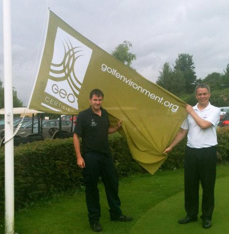 Redbourn Course Manager, Haydn Drinkwater (left) holds aloft the GEO flag with General Manager, Ian McDowell