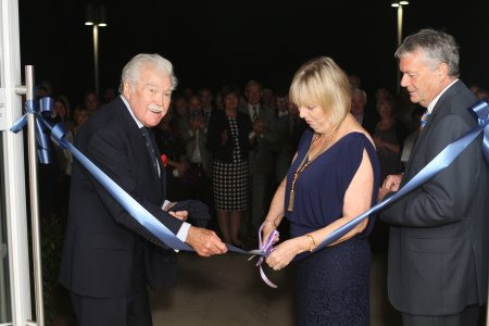 Ribbon cutting with Dickie Davies, Jennifer and Paul Gibbons