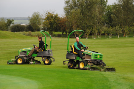 Course manager Chris Allen (right) and assistant manager Jamie Cushnaham operate The Wiltshire's two John Deere 2635B tees & surrounds mowers.