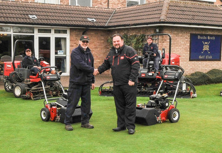 Jim Lake, left, with Lely's Jonathan Lewis and some members of the greenkeeping team