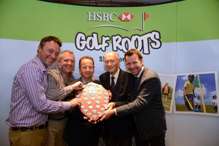 The winning team of Dynamo Silver led by Pro Robert McGuirk (centre) receives the Wickham Shield from Hugh Wickham (second from right).